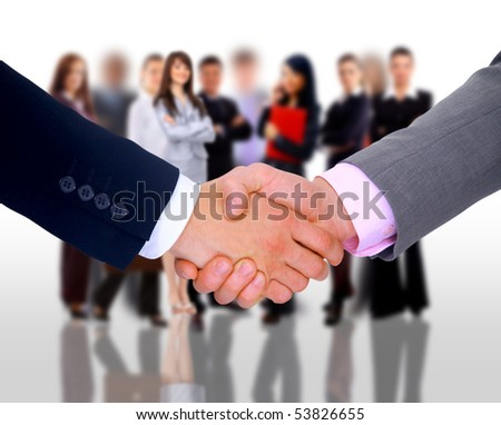 handshake and businessteam - stock photo