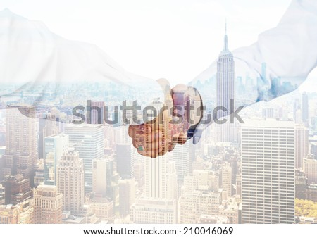 Handshake and city view background. - stock photo
