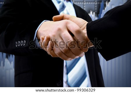 handshake and diagram - stock photo