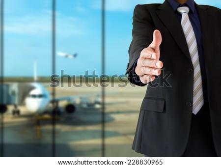 handshake and welcoming airport - stock photo