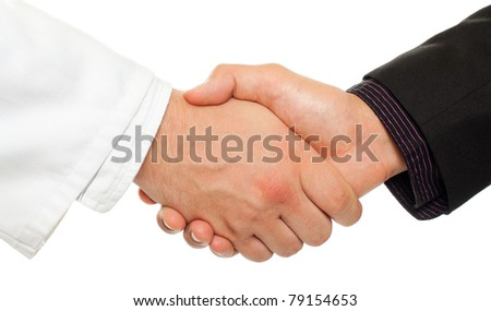 Handshake between a businessman and a doctor, isolated on white. - stock photo