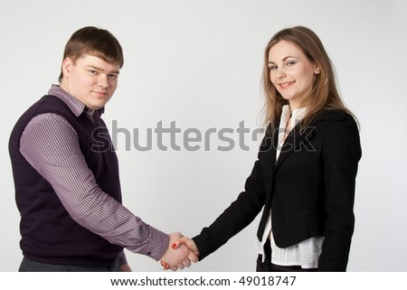 handshake between a businessman and business woman - stock photo