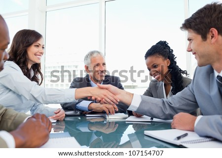 Handshake between a businesswoman and a co-worker when a meeting is ending