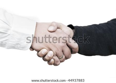 Handshake between a customer and a salesman - stock photo