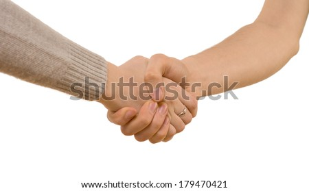 Handshake between a young man and woman wearing a long sleeve jersey as they clasp hands tightly, close up view isolated on white - stock photo