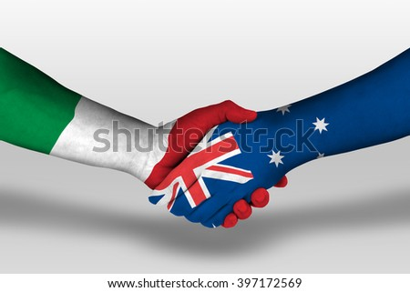 Handshake between Australia and Italy flags painted on hands, illustration with clipping path. - stock photo
