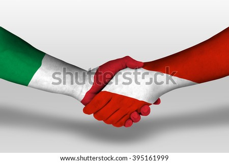 Handshake between austria and italy flags painted on hands, illustration with clipping path. - stock photo