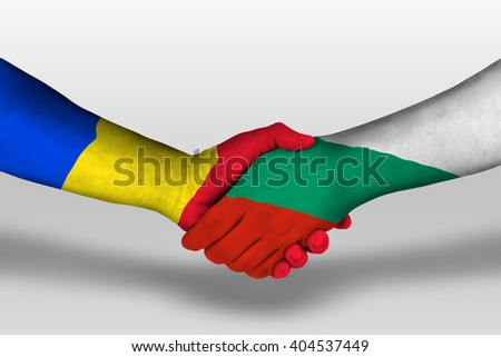 Handshake between bulgaria and romania flags painted on hands, illustration with clipping path.