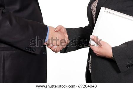 Handshake between businessman and businesswoman on white background - stock photo