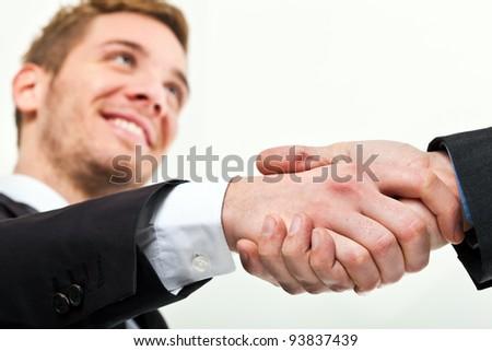 Handshake between businessmen - stock photo