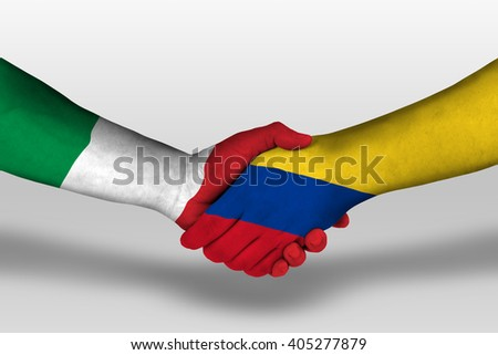 Handshake between columbia and italy flags painted on hands, illustration with clipping path. - stock photo