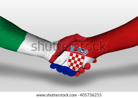 Handshake between croatia and italy flags painted on hands, illustration with clipping path. - stock photo