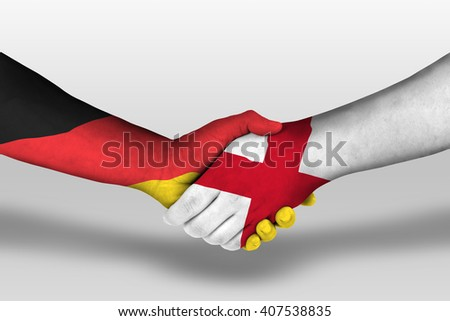 Handshake between england and germany flags painted on hands, illustration with clipping path.