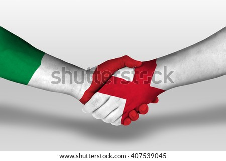 Handshake between england and italy flags painted on hands, illustration with clipping path. - stock photo