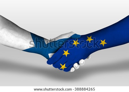 Handshake between european union and finland flags painted on hands, illustration with clipping path.