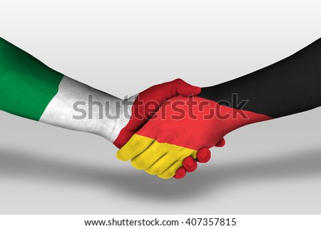 Handshake between germany and italy flags painted on hands, illustration with clipping path. - stock photo