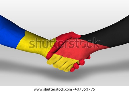Handshake between germany and romania flags painted on hands, illustration with clipping path.