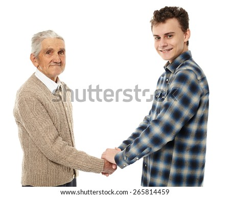 Handshake between grandfather and grandson isolated on white background - stock photo