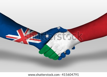 Handshake between italy and australia flags painted on hands, illustration with clipping path. - stock photo