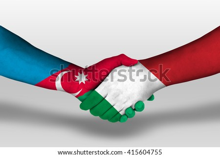 Handshake between italy and azerbaijan flags painted on hands, illustration with clipping path. - stock photo