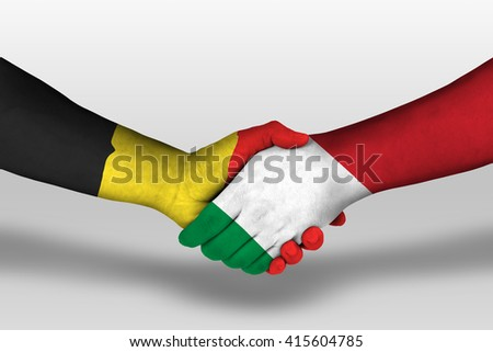 Handshake between italy and belgium flags painted on hands, illustration with clipping path. - stock photo