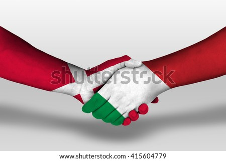 Handshake between italy and denmark flags painted on hands, illustration with clipping path. - stock photo