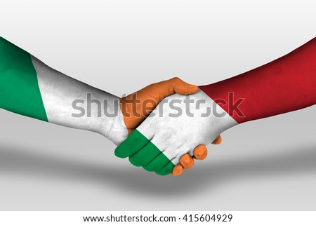 Handshake between italy and ireland flags painted on hands, illustration with clipping path. - stock photo