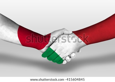 Handshake between italy and japan flags painted on hands, illustration with clipping path. - stock photo