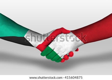Handshake between italy and kuwait flags painted on hands, illustration with clipping path. - stock photo