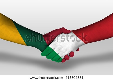 Handshake between italy and lithuania flags painted on hands, illustration with clipping path. - stock photo