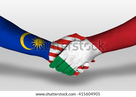 Handshake between italy and malaysia flags painted on hands, illustration with clipping path. - stock photo