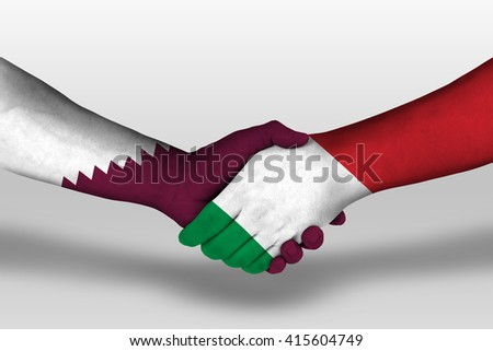 Handshake between italy and qatar flags painted on hands, illustration with clipping path. - stock photo