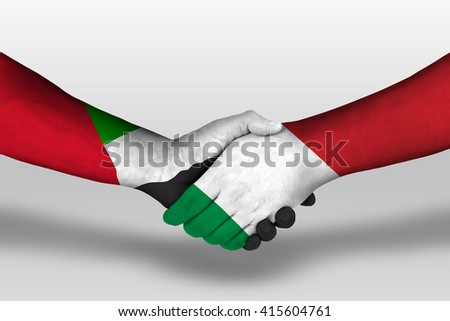 Handshake between italy and united arab emirates flags painted on hands, illustration with clipping path. - stock photo