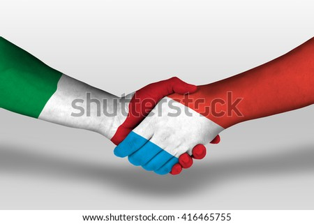 Handshake between luxembourg and italy flags painted on hands, illustration with clipping path. - stock photo