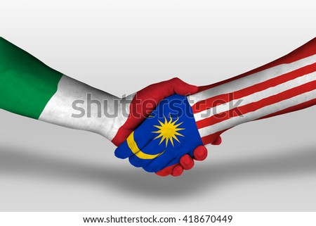 Handshake between malaysia and italy flags painted on hands, illustration with clipping path. - stock photo