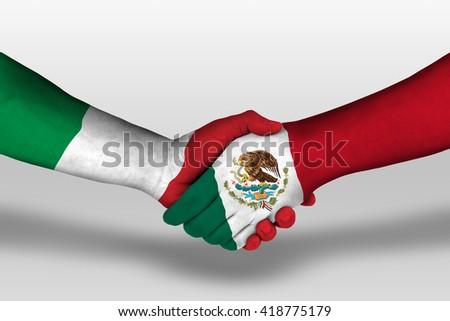 Handshake between mexico and italy flags painted on hands, illustration with clipping path. - stock photo