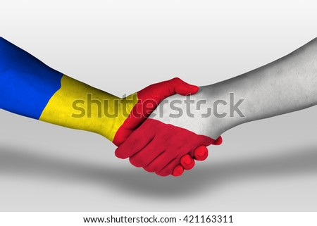 Handshake between poland and romania flags painted on hands, illustration with clipping path.