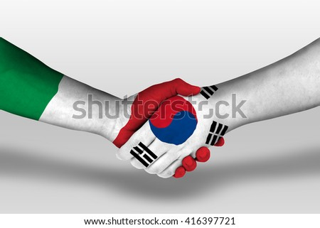 Handshake between south korea and italy flags painted on hands, illustration with clipping path. - stock photo