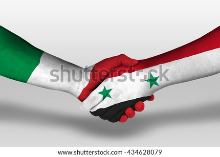 Handshake between Syria and Italy flags painted on hands, illustration with clipping path. - stock photo