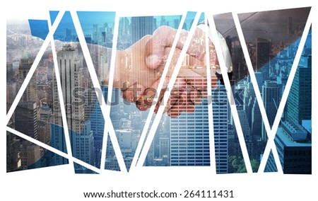Handshake between two business people against city skyline - stock photo