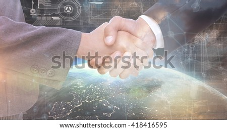Handshake between two business people against image of a earth - stock photo