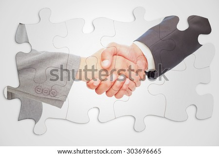 Handshake between two business people against white background with vignette - stock photo
