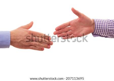 Handshake between two businessmen  - stock photo