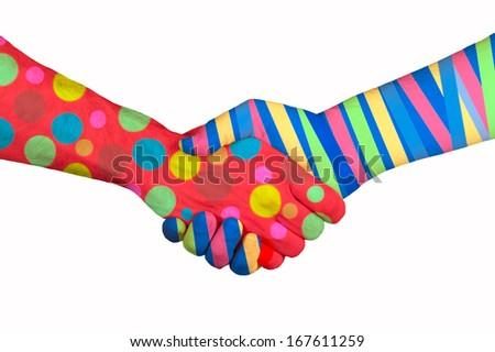 Handshake between two painted hands. - stock photo