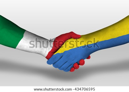 Handshake between ukraine and italy flags painted on hands, illustration with clipping path. - stock photo