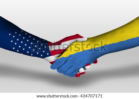 Handshake between ukraine and united states of america flags painted on hands, illustration with clipping path.