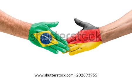Handshake Brazil and Germany - stock photo