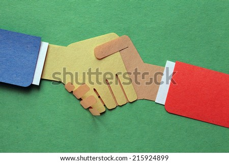 Handshake, businessmen making a deal  - stock photo
