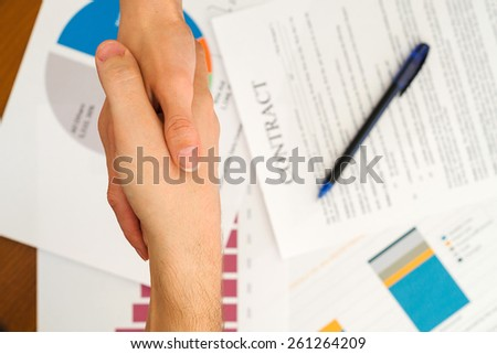 Handshake closeup of businesswoman and businessman - stock photo