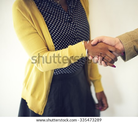 Handshake Gesturing People Connection Deal Concept - stock photo